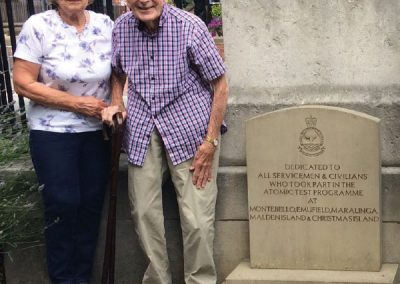 Mr & Mrs Gay beside the Memorial